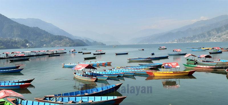 Empty boats are pictured on Phewa Lake, in Barahighat, Pokhara Metropolitan City-6, on Saturday, December 21, 2019. Photo: Rup Narayan Dhakal/THT