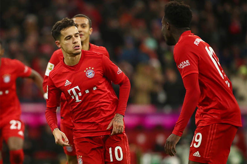 Bayern Munich's Philippe Coutinho celebrates scoring their sixth goal and scoring a hat-trick with Alphonso Davies. Photo: Reuters