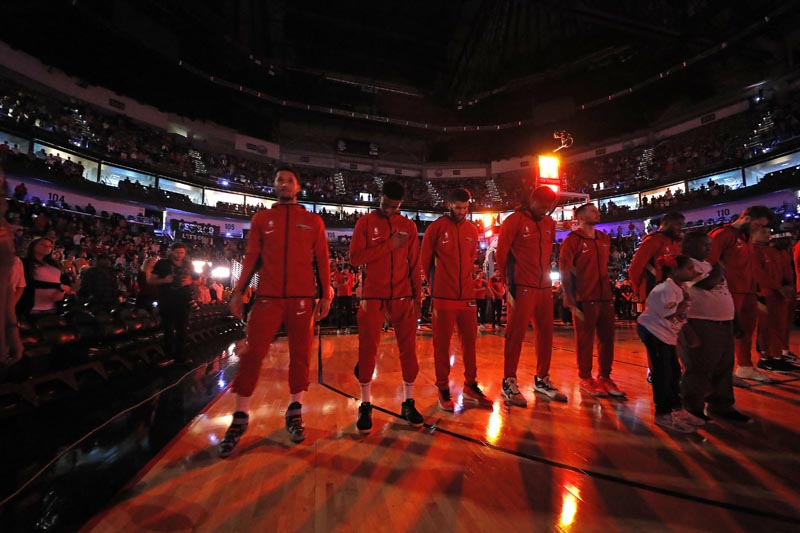 The New Orleans Pelicans pause during a moment of silence for Carley McCord, a sports journalist who was the in-game host for the Pelicans and who died in a plane crash Saturday, before the team's NBA basketball game against the Indiana Pacers in New Orleans, Saturday, December 28, 2019. Photo: AP