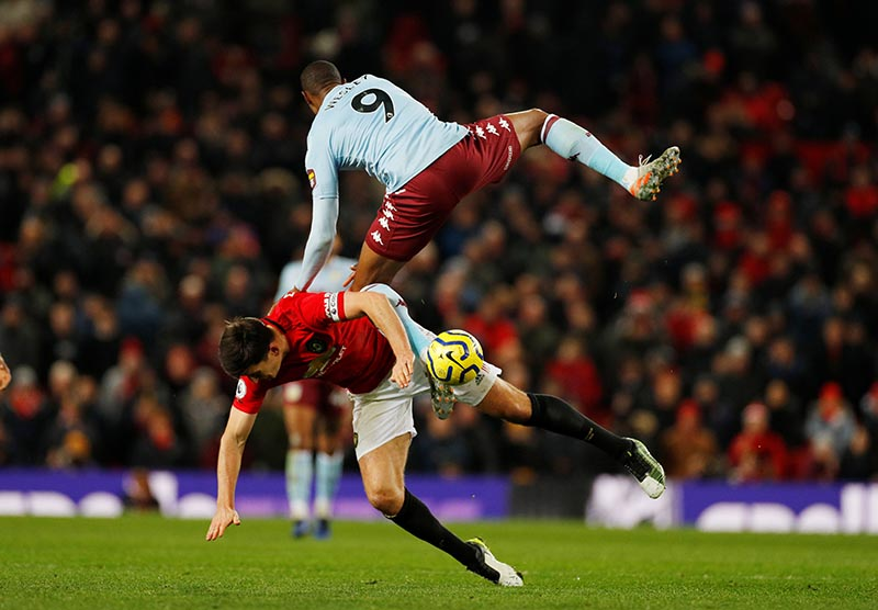 Aston Villa's Wesley in action with Manchester United's Harry Maguire during the Premier League match beteen Manchester United and Aston Villa, at Old Trafford, in Manchester, Britain, on December 1, 2019. Photo: Reuters