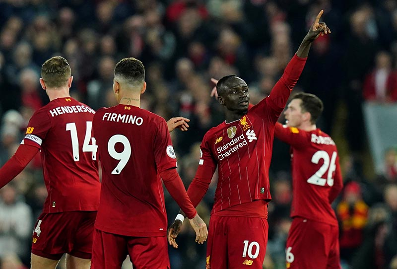 Liverpool's Sadio Mane celebrates scoring their first goal during the Premier League match between Liverpool and Wolverhampton Wanderers, at Anfield, in Liverpool, Britain, on December 29, 2019. Photo: Reuters