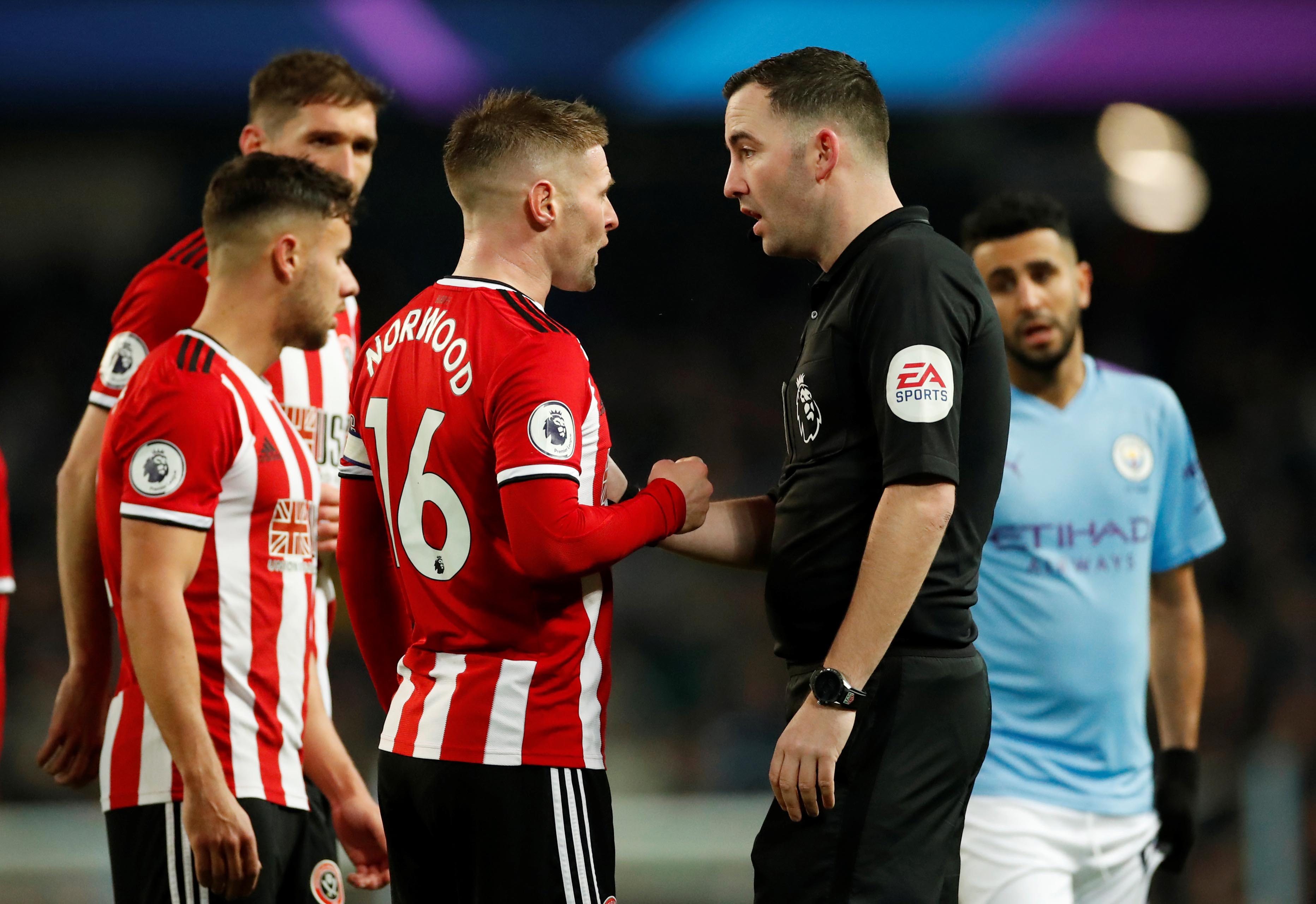 Sheffield United's Oliver Norwood appeals to referee Chris Kavanagh after Manchester City's first goal   during the Premier League match between Manchester City and Sheffield United, at Etihad Stadium, in Manchester, Britain, at December 29, 2019. Photo: Action Images via Reuters