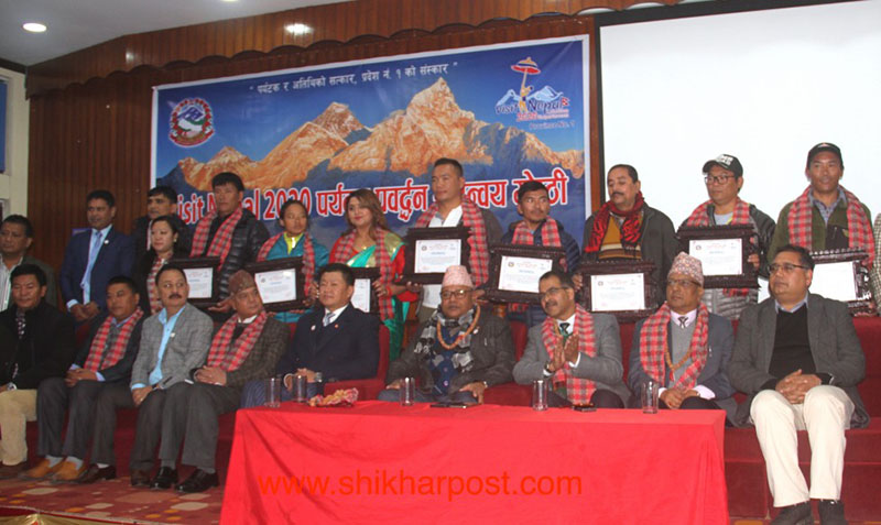 The province-level Tourism Promotion Committee of Province 1 appointing nine world-renowned climbers and celebrities as the tourism goodwill ambassadors to promote Visit Nepal Year 2020 during a programme in Province 1.