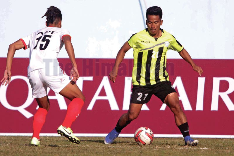 MMC's Bimal Rana (right) and APF's Rajan Gurung vie for the ball during their Qatar Airways Martyrs Memorial 'A' Division League match in Kathmandu on Wednesday, December 18, 2019. Photo: Udipt Singh Chhetry / THT