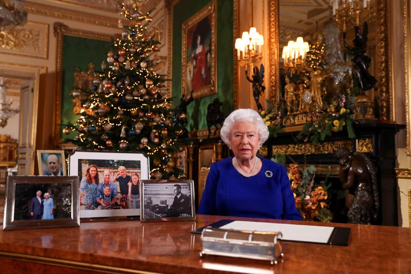 Britain's Queen Elizabeth poses, after recording her annual Christmas Day message in Windsor Castle, in Berkshire, Britain, in this undated pool picture released on December 24, 2019. Photo: Steve Parsons/Pool via Reuters