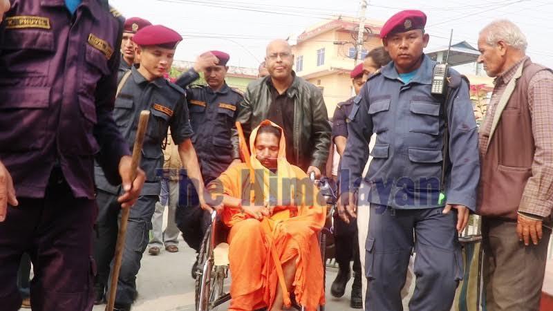 Rape accused Krishnadas Giri, also known as Siddhababa, being taken to Sunsari District Court for remand, on Monday. Photo: THT