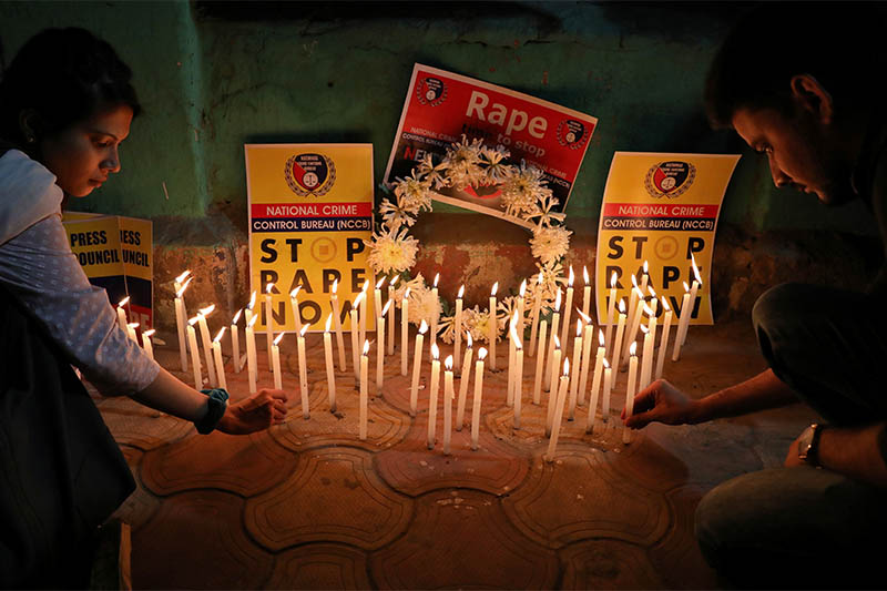 People light candles during a vigil as they attend a protest against the alleged rape and murder of a 27-year-old woman, in Kolkata, India, December 4, 2019. Photo: Reuters