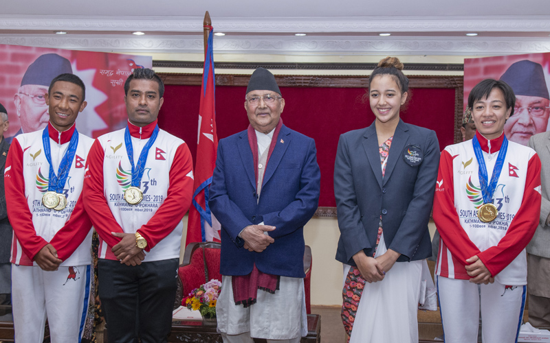 Prime Minister KP Sharma Oli with the gold medalists of the 13th South Asian Games, amidst a programme held in Prime Minister's official residence, as seen on Wednesday, December 11, 2019. Photo Courtesy: Prime Minister's Office