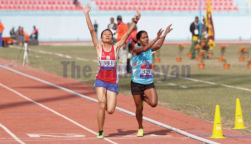 Nepal's Santoshi Shrestha (left) celebrates after crossing the finish line a fraction of a second ahead of Indian athlete Kabita Yadav to win the 10,000m race of the 13th South Asian Games in Dasharath Stadium, Kathmandu, on Tuesday. Photo: THT