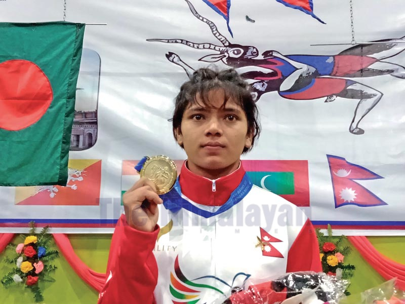 Sangita Dhami poses for a photo after winning gold medal in wrestling event under the 13th SA Games in Janakpurdham on Saturday, December 7, 2019. Photo: THT
