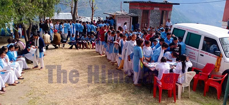 Doctors offering consultation service to the teenage students queuing up at a sexual and reproductive health camp organised by ADRA Nepal, at Tante Health Post, in Budhiganga Municipality, Bajura district, on Friday, December 6, 2019. Photo: Prakash Singh/THT