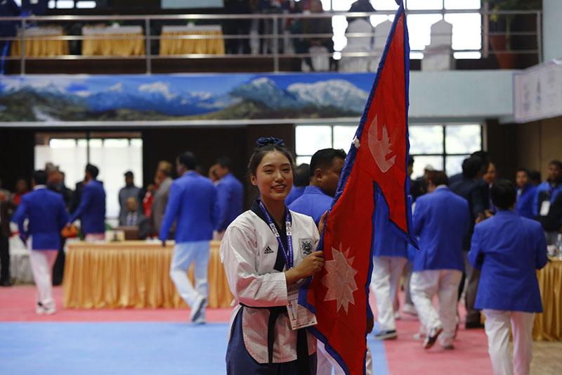 Sina Maden Limbu after winning the Womenu2019s Individual Poomsae of Taekwondo under 17-23 age category, at Taekwan do Hall in Satdobato, Lalitpur. Photo: RSS