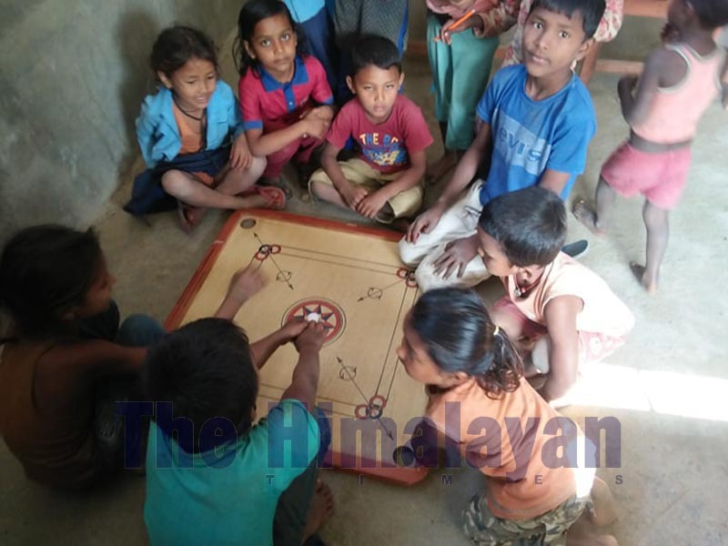 Children playing carrom during teacheru2019s absence from class at Janata Basic Level School, in Siraha, on Thursday, December 12, 2019. Photo: THT
