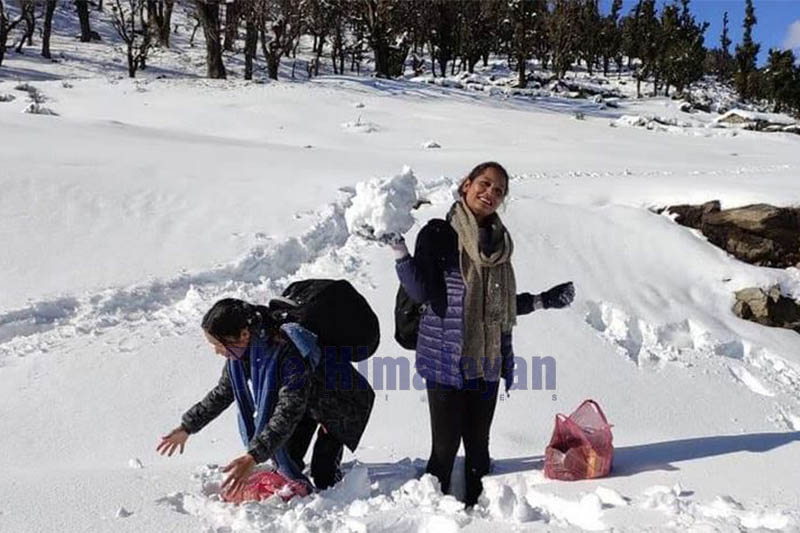 Women are seen playing with snow as they walk along Martardi--Kolti raod section in Bajura district, on Sunday, December 15, 2019. Photo: Prakash Singh/THT
