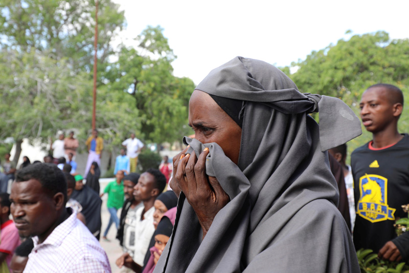 A Somali woman reacts at the scene of a car bomb explosion at a checkpoint in Mogadishu, Somalia, December 28, 2019. Photo: Reuters