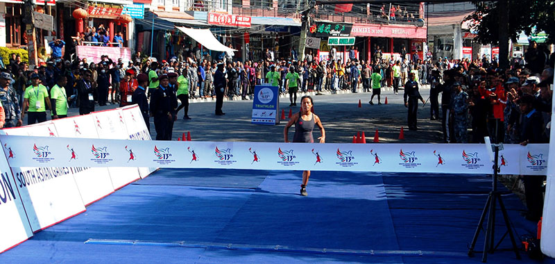 Nepal's Soni Gurung during the Triathlon competition under the 13th South Asian Games (SAG) in Pokhara, on Monday, December 2, 2019. Photo: RSS