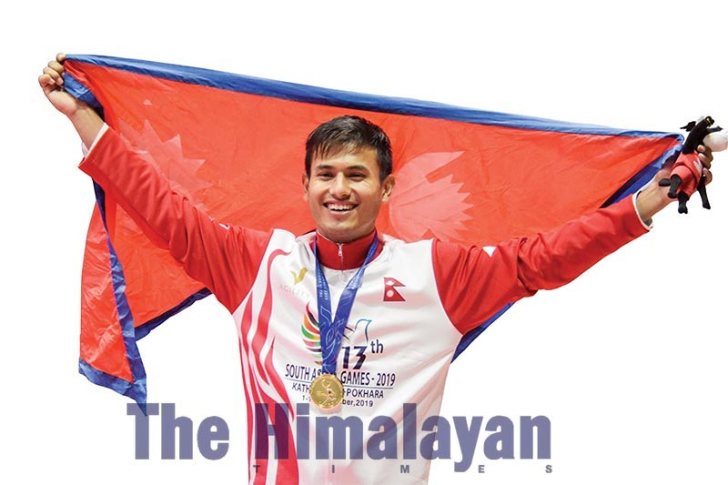 Taekwondo player Saksham Karki celebrating after winning a gold medal in the above-87kg category, in Kathmandu, on Wednesday, December 4, 2019. Photo: Naresh Shrestha/THT