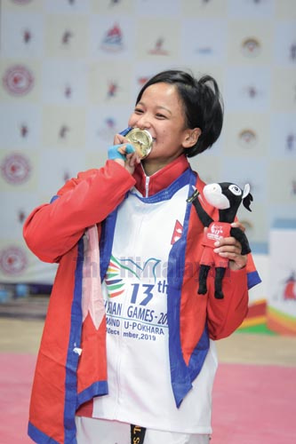 Taekwondo player Kajal Shrestha celebrates after winning a gold medal in 13th South Asian Games in Lalitpur on Tuesday, December 3, 2019. Photo: THT
