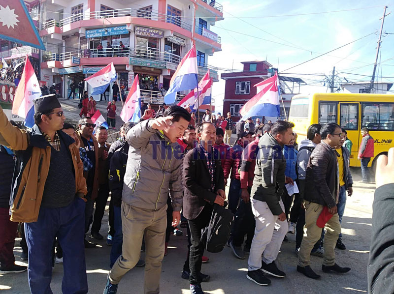 Nepali Congress-aligned Nepal Tarun Dal leaders and cadres staging a protest rally warning that graft accused Chief District Officer Khagendra Rijal should leave district within 24 hours, in Charikot, Dolakha, On Friday. Photo: Gokarna Bhandari/THT