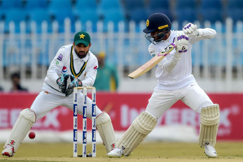 Sri Lankan players plays a shot as Pakistani wicket-keeper looks on during the first test match in Rawalpindi, on Friday, December 13, 2019. Courtesy: ICC/Twitter