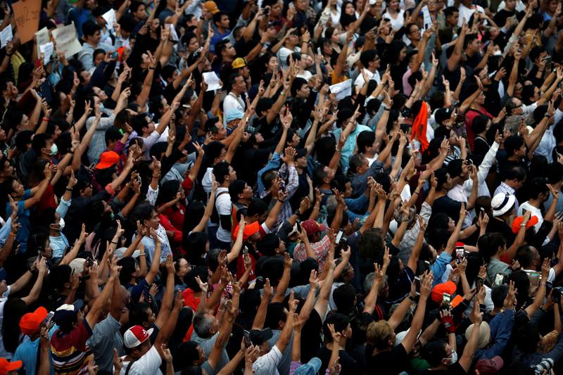 Supporters wave their hands during an unauthorised flash mob rally by the progressive Future Forward Party in Bangkok, Thailand December 14, 2019. Photo: Reuters