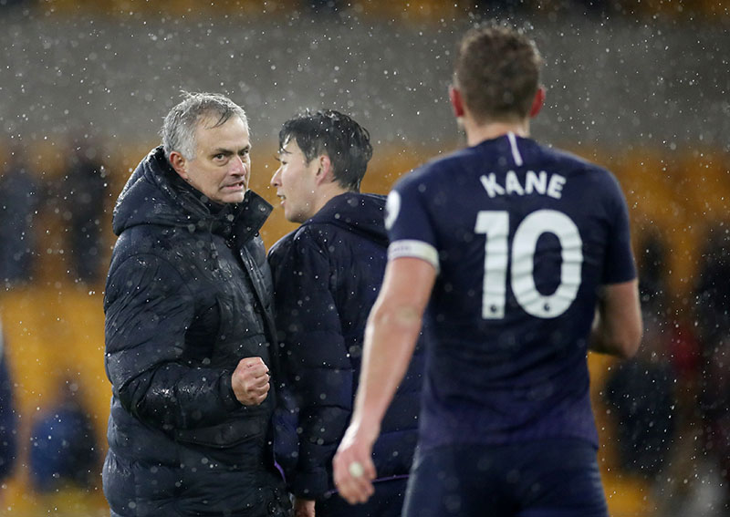 Tottenham Hotspur manager Jose Mourinho and Harry Kane celebrate after the match during the Premier League match between Wolverhampton Wanderers and Tottenham Hotspur, at Molineux Stadium, in Wolverhampton, Britain, on December 15, 2019. Photo: Action Images via Reuters