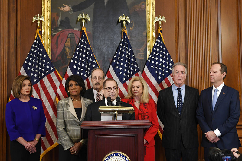 From left, House Speaker Nancy Pelosi, Chairwoman of the House Financial Services Committee Maxine Waters, D-Calif, Chairman of the House Foreign Affairs Committee Eliot Engel, D-NY, House Judiciary Committee Chairman Jerrold Nadler, D-NY, Chairwoman of the House Committee on Oversight and Reform Carolyn Maloney, D-NY, House Ways and Means Chairman Richard Neal and Chairman of the House Permanent Select Committee on Intelligence Adam Schiff, D-Calif, unveil articles of impeachment against President Donald Trump, during a news conference on Capitol Hill, in Washington, Tuesday, December 10, 2019. Photo: AP