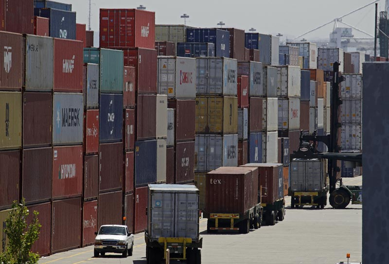 FILE- In this July 22, 2019, file stacked containers wait to be loaded on to trucks at the Port of Oakland in Oakland, California. Photo: AP