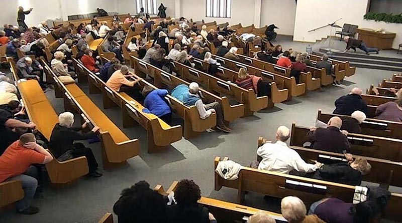 In this still frame from livestreamed video provided by law enforcement, churchgoers take cover while a congregant armed with a handgun, top left, engages a man who opened fire, near top center just right of windows, during a service at West Freeway Church of Christ, Sunday, December 29, 2019, in White Settlement, Texas. Photo: West Freeway Church of Christ/Courtesy of Law Enforcement via AP