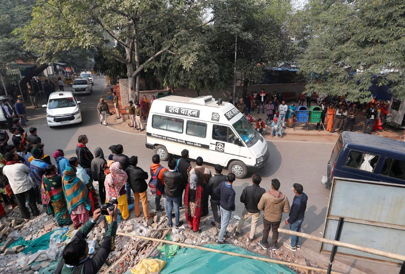 A hospital vehicle carries the body of a rape victim to her residence in New Delhi, India, December 7, 2019. Photo: Reuters