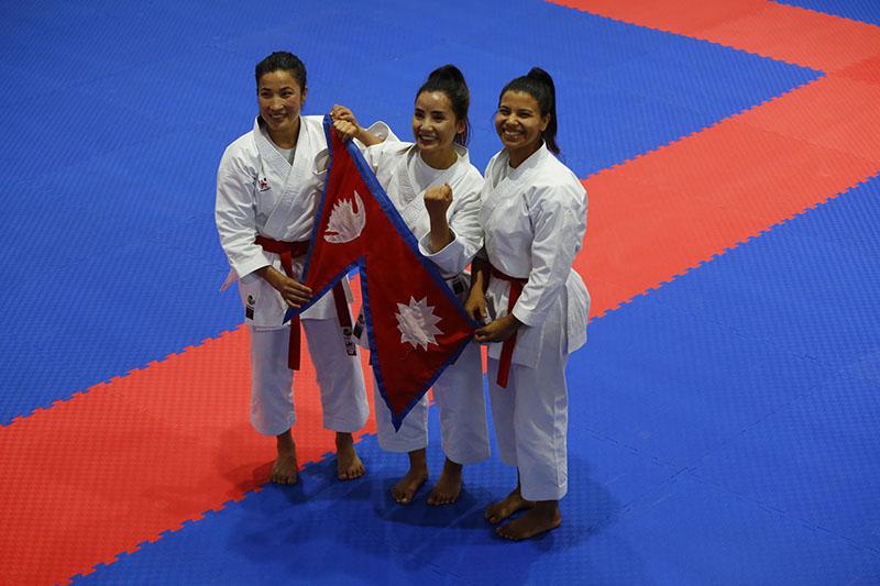 Nepal's Nirmala Tamang, Suru Karki and Sangita Magar after winning gold medal in Women's Team Kata Category of Karate at Nepal Karate Academy in Satdobato, Lalitpur, on Monday, December 02, 2019. Photo: RSS