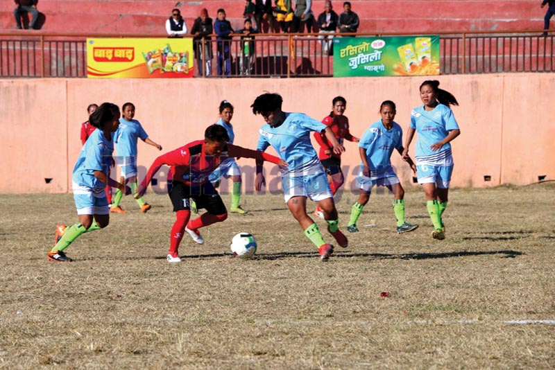 Players of Nepal Police Club (centre) and Basah Rising Youth Club in action during their Martyr Ridamahang-Ramalihang Aathpahariya first Womenu2019s Gold Cup match in Dhankuta on Monday, December 30, 2019. Photo: THT
