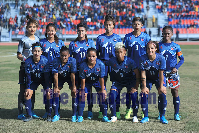 Nepal national women's football team pose for a group photo prior to their game against the Maldives during 13th South Asian Games, in Pokhara, on Thursday, December 05, 2019. Photo: Rup Narayan Dhakal/THT