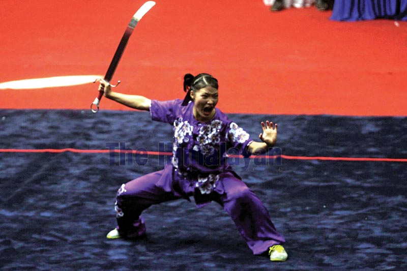 Wushuka Nima Gharti Magar performs in taoluu2019s nanquan allround event, under the 13th South Asian Games on Thursday, December 5, 2019. Photo: Udipt Singh Chhetry/THT