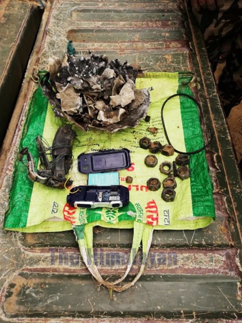 A pressure cooker bomb, found inside a bag in Ishanath Municipality of Rautahat district, is defused by the bomb disposal squad of Nepal Army, on Wednesday, December 25, 2019. Photo: Prabhat Kumar Jha/THT