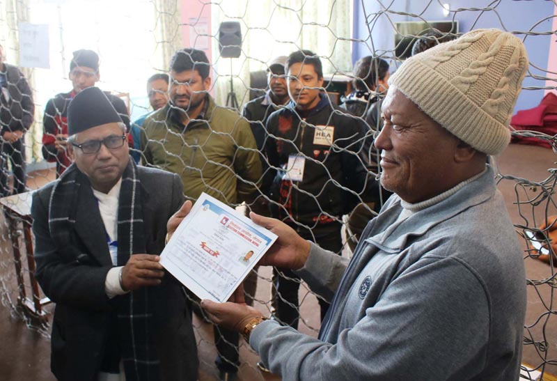 Chief Election Officer Jagat Narayan Pradhan giving the certificate to Nepali Congress candidate Krishna Lal Bhandel who won the by-election for the State Assembly (SA) Member from Bhaktapur constituency 1(a). Photo: RSS