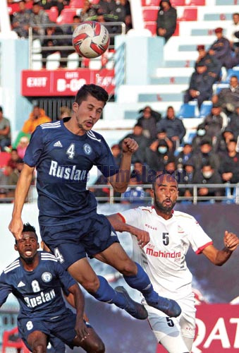 Three Star Clubu2019s Ananta Tamang (left) jumps to head the ball during the Qatar Airways Martyrs Memorial A Division League match against Nepal APF Club in Kathmandu on Saturday, December 28, 2019. Photo: Udipt Singh Chhetry / THT