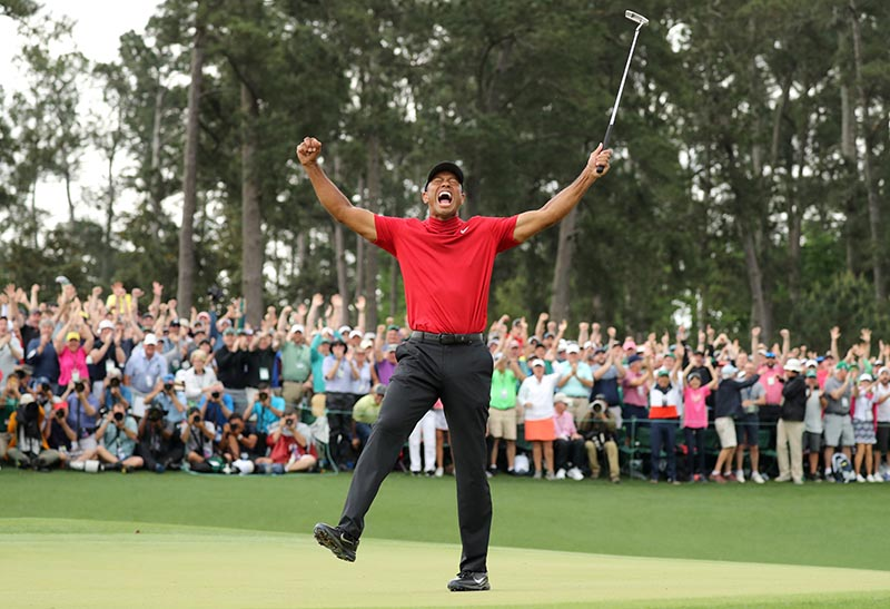 Golf - Masters - Augusta National Golf Club - Augusta, Georgia, U.S. - April 14, 2019. Tiger Woods of the U.S. celebrates on the 18th hole to win the 2019 Masters. Photo: Reuters
