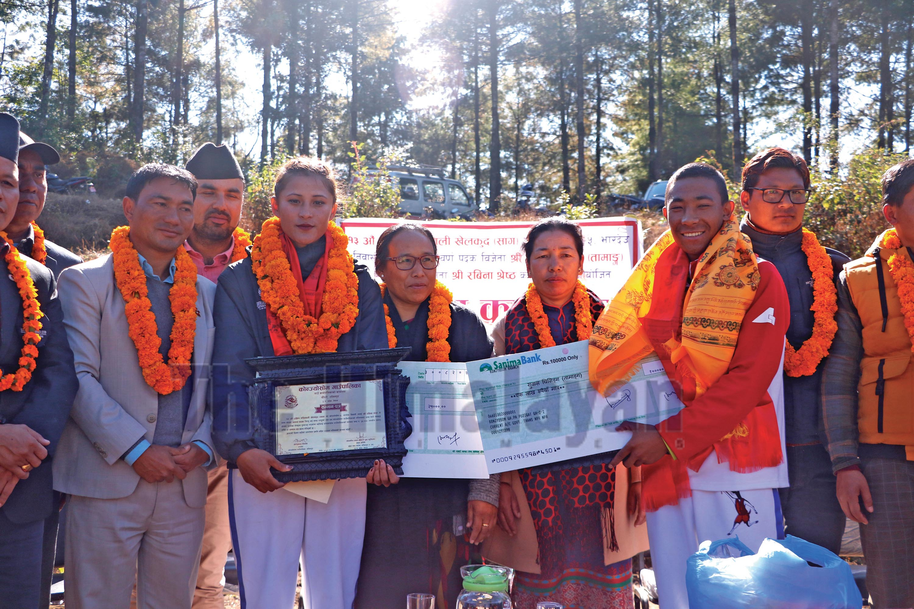 The 13th SA Games medallists Subash Tamang and Rabina Shrestha with officials at a programme organised by Konjyosom Rural Municipality on Tuesday. Photo: THT