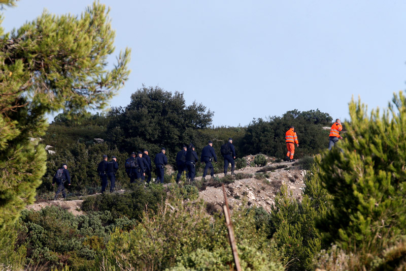 French police and emergency services work around the site where a helicopter from the civil security services crashed while en route to help people caught up in heavy flooding, in Le Rove near Les-Pennes-Mirabeau, France, December 2, 2019. Photo: Reuters