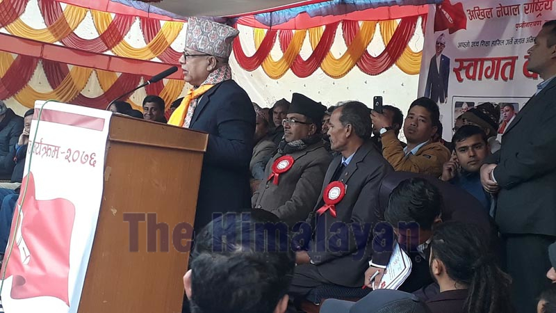 Nepal Communist Party (NCP) senior leader Madhav Kumar Nepal is seen addressing a welcome programme for new students organised by the All Nepal National Free Students Union (ANNFSU) at Prithvi Narayan Campus, in Pokhara, on Thursday, December 26, 2019. Photo: Rishi Baral/THT