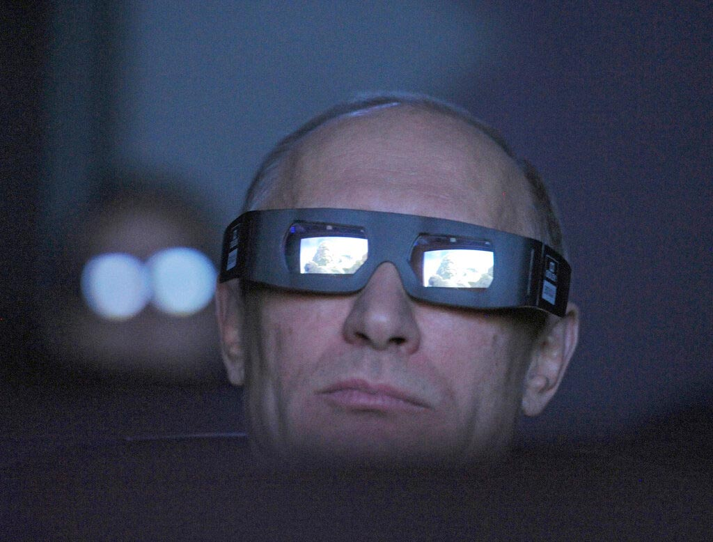 In this file photo taken on Thursday, April 12, 2012, Russian Prime Minister Vladimir Putin wears 3D glasses as he visits Moscow's Planetarium in Moscow, Russia. Russian President Vladimir Putin prepares to mark his 20th year in power, as the longest-serving leader since Joseph Stalin. Photo: AP