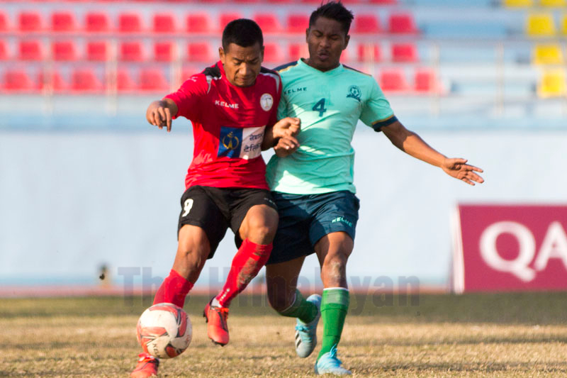 NCP's Suman Lama(left) vies with SYC's Purna Bahadur Shreshta during their Qatar Airways Martyrs Memorial A Division League match in Kathmandu on December 27, 2019, Friday.