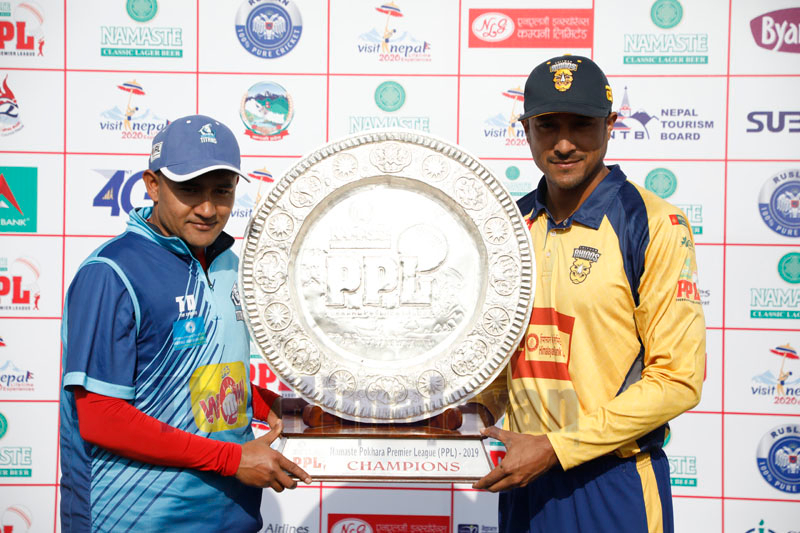 Chitwan Rhinos skipper Paras Khadka (right) and his Biratnaga Titans counterpart Pradeep Airee hold the trophy in Pokhara on December 27, 2018, Friday, on the eve of the Namaste PPL final.