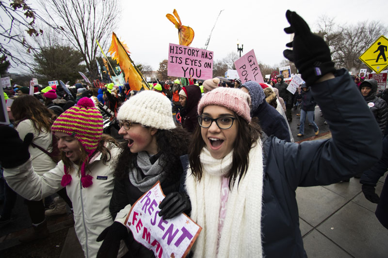 Georgetown students, from left, Emma Garman, Annmarie Rotatori and Claire Tebbutt, join the Women's March near the White House, Saturday, Jan. 18, 2020, in Washington.  Photo: AP
