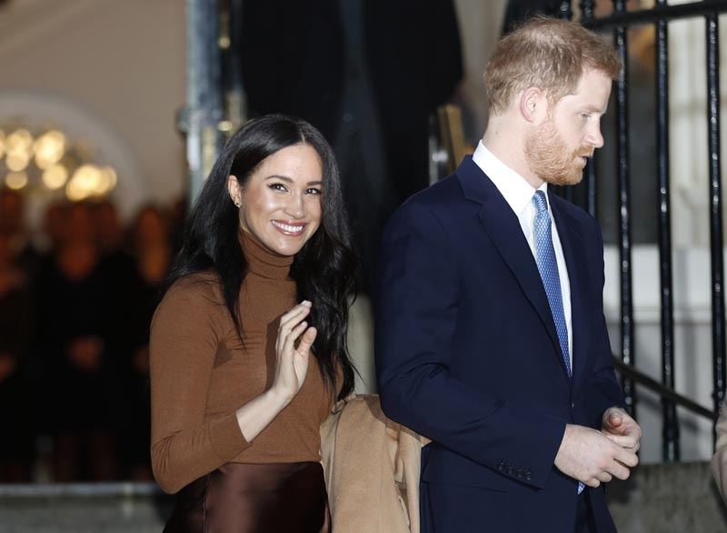 FILE - In this Jan. 7, 2020, file photo, Britain's Prince Harry and Meghan, Duchess of Sussex leave after visiting Canada House in London, after their recent stay in Canada. Photo: AP