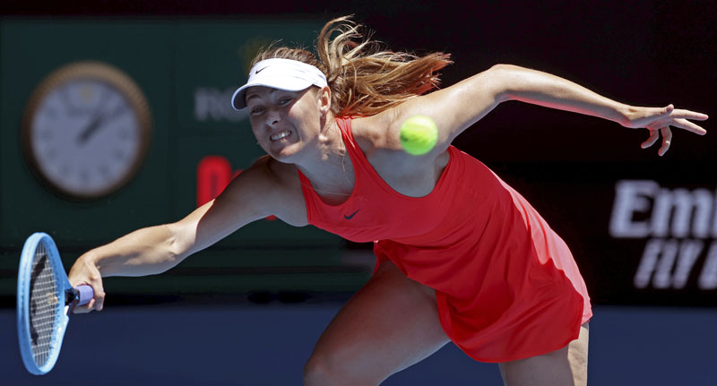 Russia's Maria Sharapova makes a forehand return to Croatia's Donna Vekic during their first round singles match at the Australian Open tennis championship in Melbourne, Australia, Tuesday, Jan. 21, 2020. Photo: AP