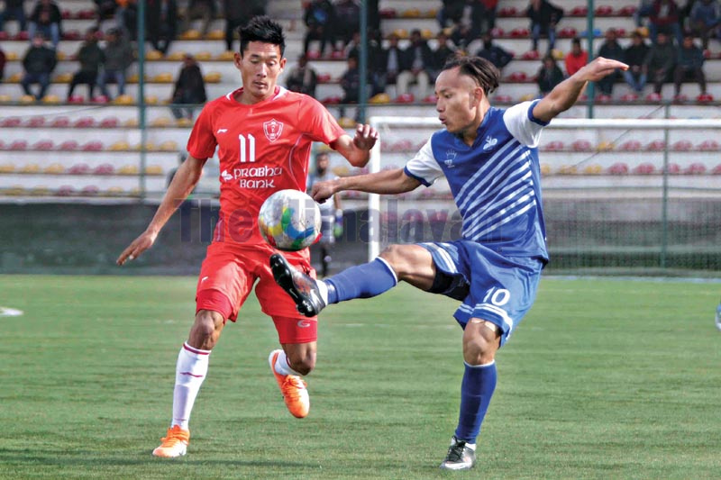 Bijaya Ghalan (left) of Prabhu Jawalakhel Youth Club vies for the ball with Sunil Bal of Chyasal Youth Club during their Qatar Airways Martyrs Memorial A Division League match at the ANFA Complex grounds in Lalitpur on Tuesday, December 31, 2019. Photo: Udipt Singh Chhetry / THT