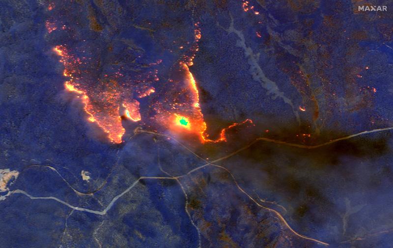 A satellite image shows wildfires burning east of Obrost, Victoria, Australia January 4, 2020. Satellite image u00a92020 Maxar Technologies/Handout via Reuters
