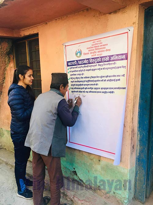 A patient putting his signature on the banner against the Chhaupadi practice after he was counselled in District Ayurved Health Centre, Bajura, on Tuesday, January 28, 2020. Photo: THT